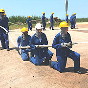 FIRE FIGHTING STUDENTS IN POSITION.